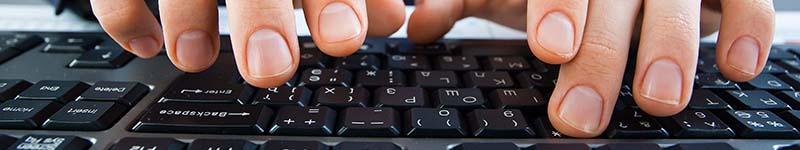 Keyboard hands - stock photo